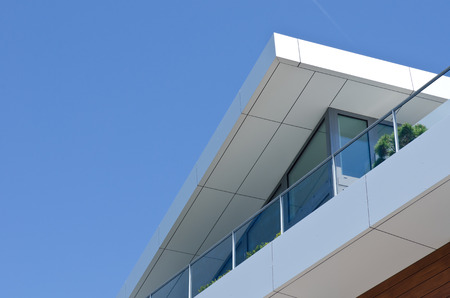 modern architecture, Penthouse detail view, blue sky, modern living, Stock Photo