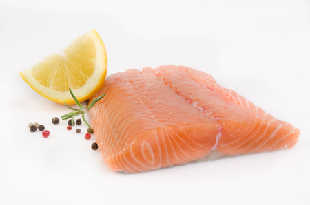 peppercorns: Salmon fillet with peppercorns and Rosemary spice on white background Stock Photo