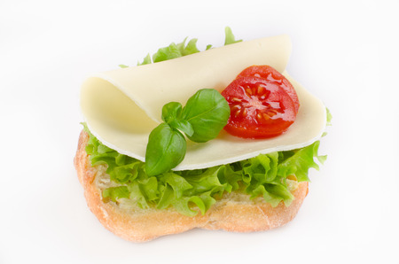 sandwich with cheese,tomato and lettuce topped
