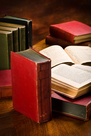 antiquary: old books in the library with damaged a bind Stock Photo