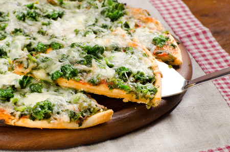appetizing pizza with spinach and cheese cooked at home Standard-Bild