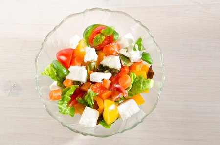 mixed colored tomato salad with feta cheese and carrots