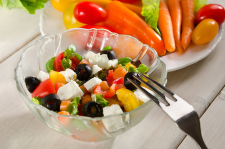 mixed salad with olives, tomatoes and feta cheese