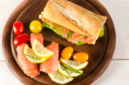salmon baguette with lemon, tomato and chives