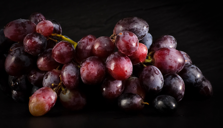 Grapes on a black background Standard-Bild