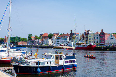 Luebeck, Germany-22 June 2017, view from the Hanseatic harbour on the below Trave Street with historical facades Editorial