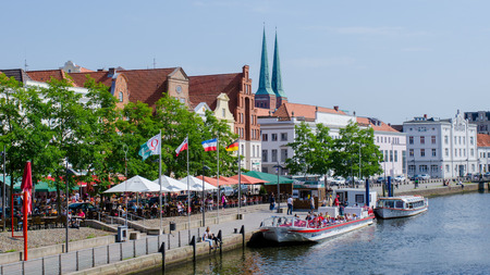Luebeck, Germany-22 June 2017, view of the Upper Trave Street with street cafes on a beautiful summer day Editorial
