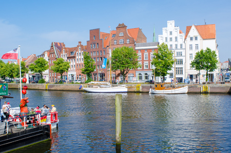 Luebeck, Germany-22 June 2017, city view with historical facades on the untertrave Street