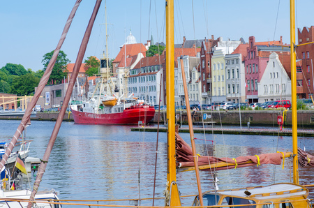 Luebeck, Germany-22 June 2017, view from the Hanseatic harbour to the fire-ship Fehmarn Belt in the foreground