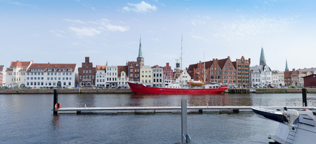 Luebeck, city view with historical facades on the untertrave Street with fire ship Standard-Bild