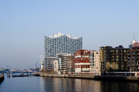 Hamburg harborcity, Apartment houses on the river Elbe, in the background the Elbphilharmonie