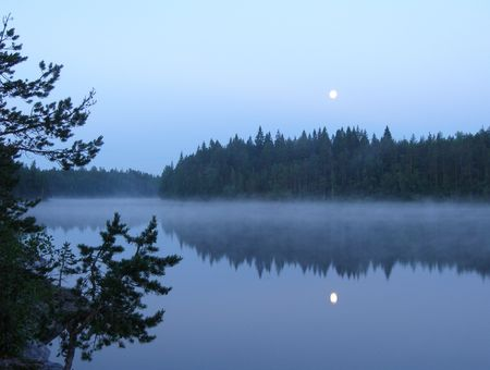 Moon and morning fog on wild forest lake Stock Photo - 918100