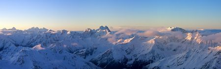 Panoramic view on Greater Caucasus in sunrise from Mt.Elbrus. Caucasus Mountains, Russia photo