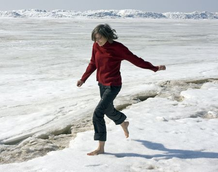 barefoot people: girl running barefoot on snow