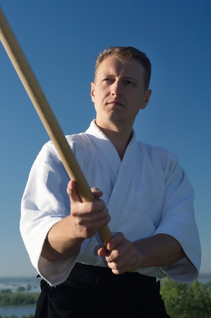 a young man are training in Aikido on the beach photo