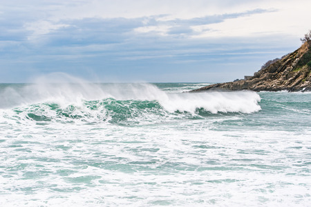Stormy sea with beautiful turquoise water and scenic spraying waves