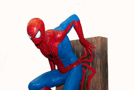 Valladolid, Spain - march 8, 2020 : Spider-Man model sit down is isolated on white background of character from Spiderman movie franchise. Spider-Man is a fictional superhero in Marvel Comics.