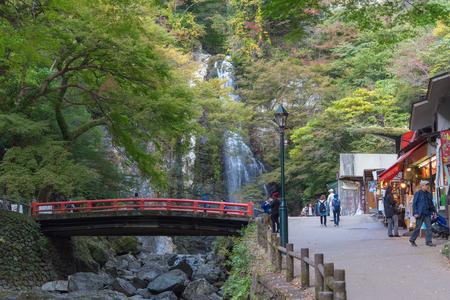 quasi: OSAKA, JAPAN - November 5: Mino Falls Meiji-no-mori Mino Quasi-national Park Mino Waterfall Minoo Park Stream - take photo in early autumn season before red maple grown Editorial