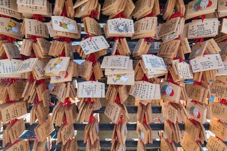 dera: Kyoto, Japan - November 6, 2015: Dragon wooden prayer tablets at Kiyomizu dera - Kyoto. Pray for happieness, healthy, luck by write a word on wooden tablet. Editorial