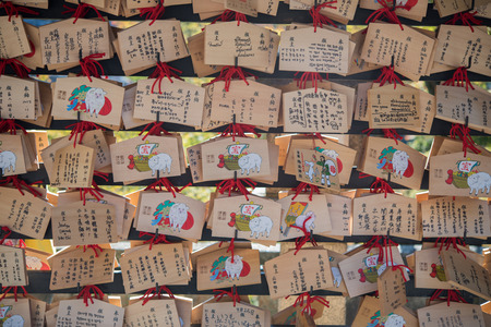 happieness: Kyoto, Japan - November 6, 2015: Dragon wooden prayer tablets at Kiyomizu dera - Kyoto. Pray for happieness, healthy, luck by write a word on wooden tablet. Editorial
