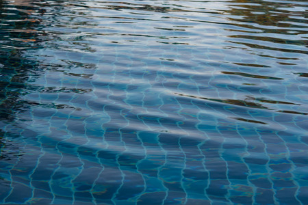 rips: Dark blue ripped water in swimming pool