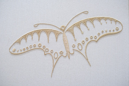 sewn: Embroidery butterfly on cotton background Stock Photo