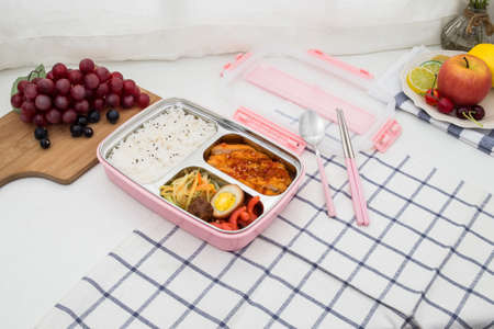 Colorful plastic bento cutlery boxes on the table