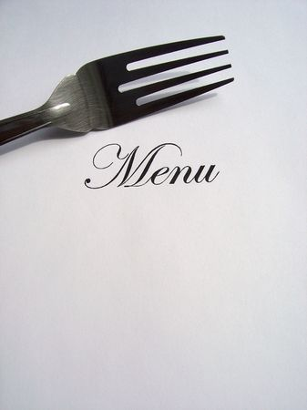 Close up view of the word Menu written and a fork all on a white background with free space to write what you want Stock Photo