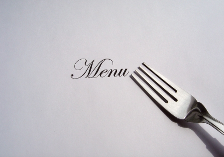 Close up view of the word Menu written and a fork all on a white background with free space to write what you want photo