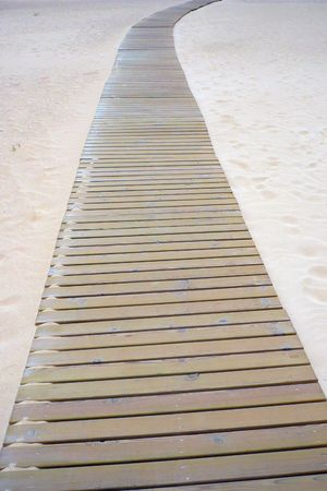 wood gangplank on the sand of the beach Stock Photo - 5452639