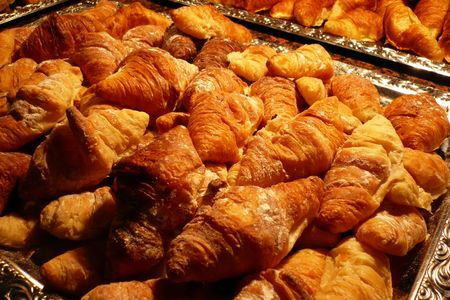 close up view of a croissant bread tray