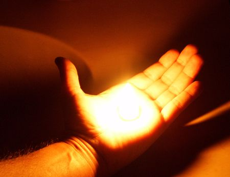 human palm: flame in a hand Stock Photo