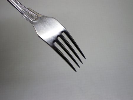 Fork on a grey shadow background       Stock Photo - 6301397