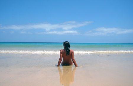 Beauty girl on the ocean shore