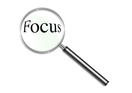 business focus: Magnifying glass over the word Focus