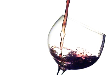 liqueur bottle: Pouring red wine in a cup Stock Photo
