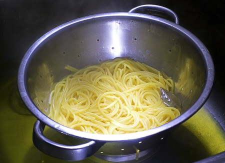 spaghetti in a drainer