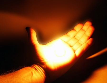 hand offering help with light inside