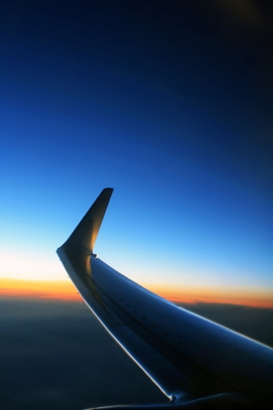 Airplane wing at dusk photo