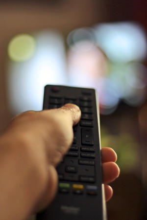 sports programme: TV Remote control device in hand