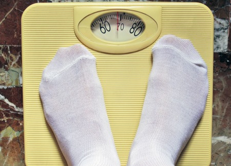 weighing in a scale Stock Photo