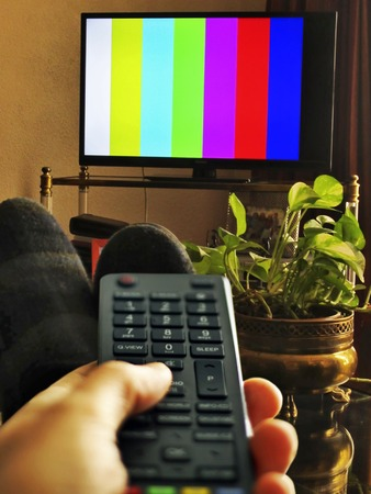 sports programme: Watching TV Stock Photo