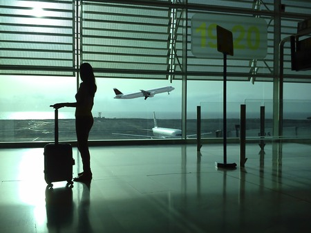 Woman with a suitcase in the airport photo