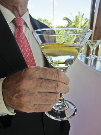 Man hand holding martini cocktail