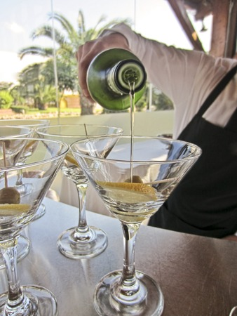 Bartender pouring cocktail martini