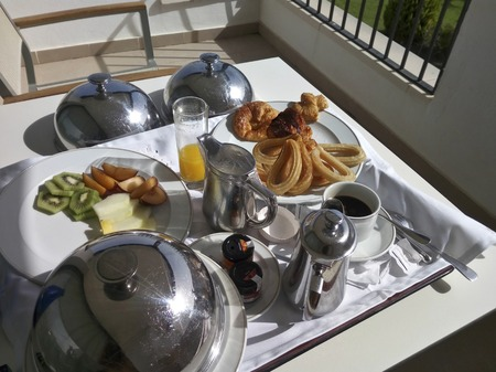 spanish room service breakfast with churros Imagens