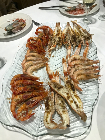Source of seafood grilled with red shrimp, white shrimp and crayfish