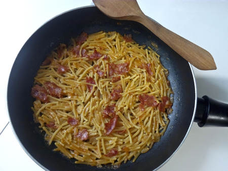 Noodles in pan with sausage