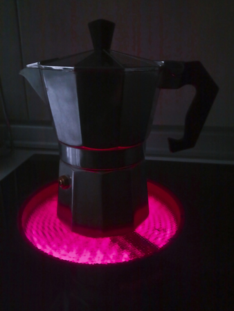 Italian coffee machine working in the dark