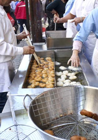 Cooking pumpkin fritters in Valencia, spain
